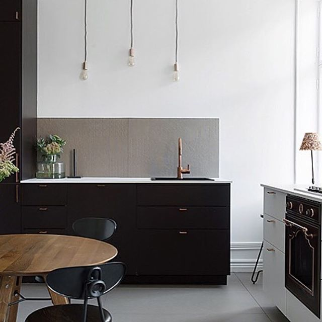 We are loving the dark cabinets in this kitchen forhellip